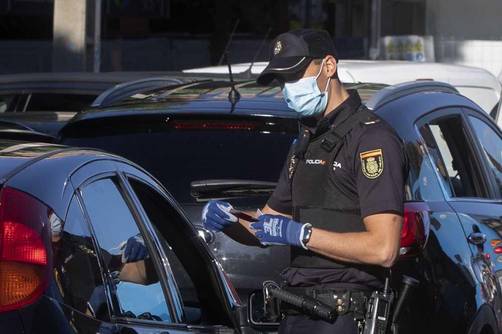 Madrid starts partial virus lockdown amid political scuffle