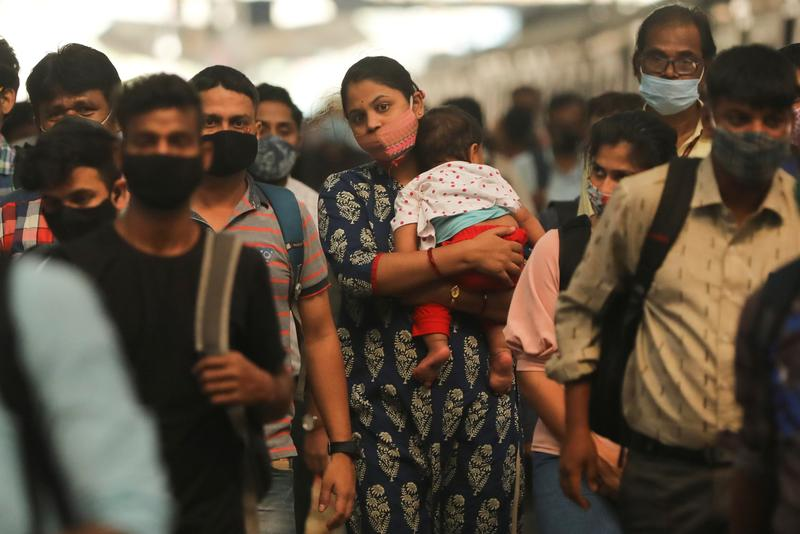 India says new virus variants not behind rise in cases in two states