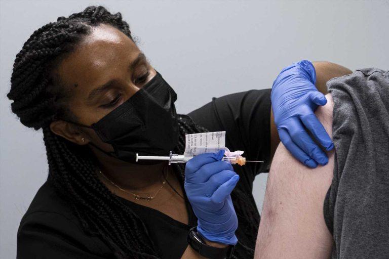 Tweaked COVID vaccines in testing aim to fend off variants